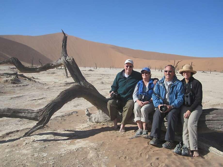 Pamela Rey of San Ramon (far right) with Bob and Julia Phelps and husband Jeff Hicks at Deadvlei Pan in the Namib Naukluft Park. Photo: Courtesy Of Pamela Rey