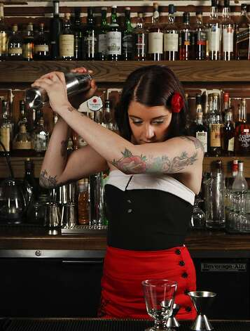 Chronicle Bar Star, Morgan Young of Fifth Floor and 15 Romolo, mixes a Sweet Peat at Burritt Room in San Francisco, Calif., on Tuesday, May 10, 2011. Photo: Russell Yip, The Chronicle