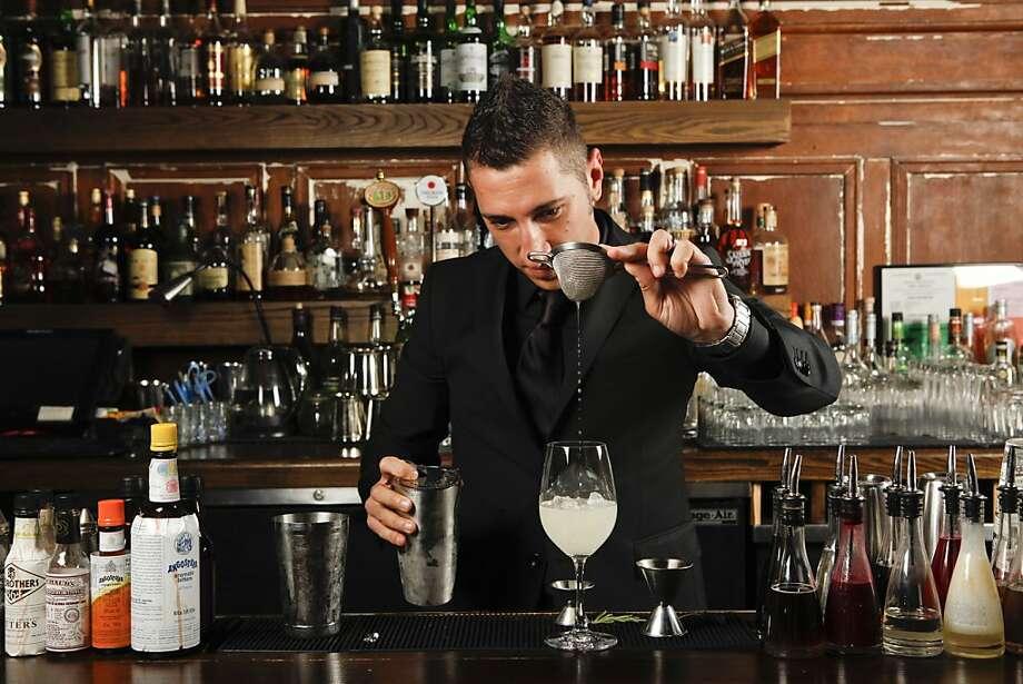 Chronicle Bar Star, Carlo Splendorini of Michael Mina, mixes a Lavanda 2.0 at Burritt Room in San Francisco, Calif., on Tuesday, May 10, 2011. Photo: Russell Yip, The Chronicle