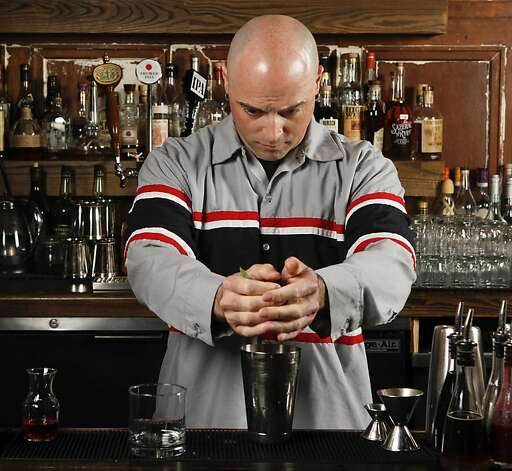 Chronicle Bar Star, Alex Smith of Gitane, mixes a Narguja at Burritt Room in San Francisco, Calif., on Tuesday, May 10, 2011. Photo: Russell Yip, The Chronicle