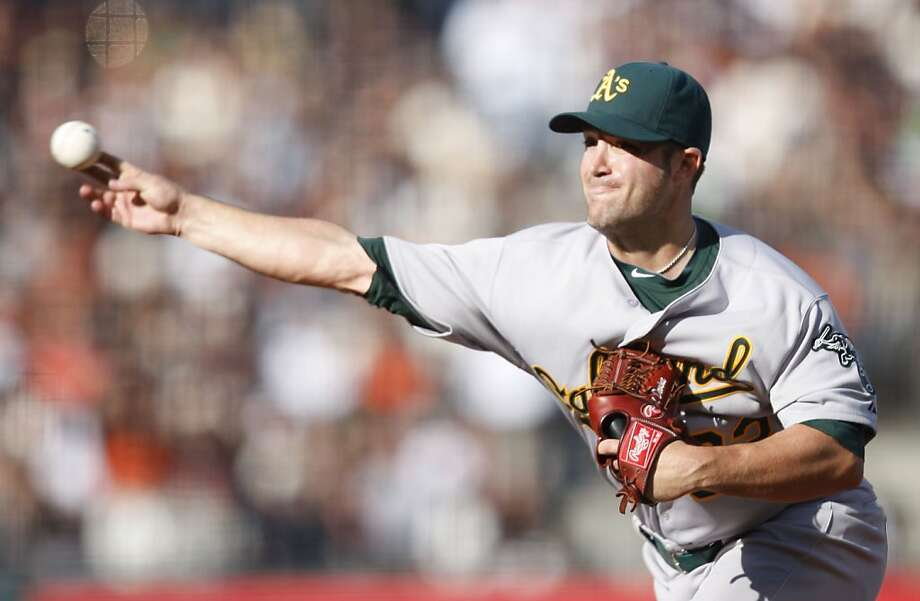 Oakland Athletics' Joey Devine pitches during the 6th inning. As the San Francisco Giants take on the Oakland Athletics at AT&T Park in San Francisco, Calif., on Saturday, May 21, 2011. Photo: Thomas Levinson, The Chronicle