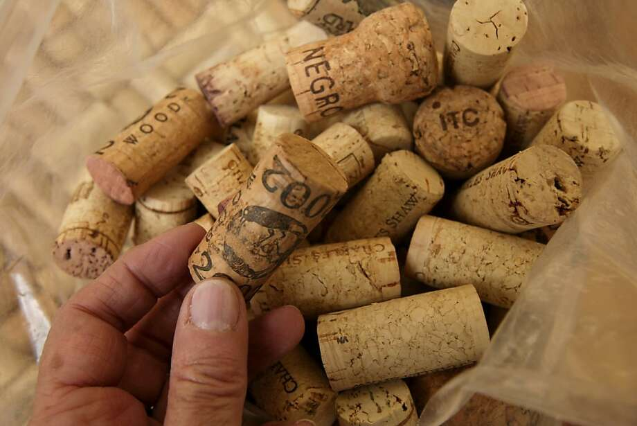 Linda Levitsky picks corks from a bag to place into a picture frame its part of a project being done by East Bay Depot for Creative Reuse. on Thursday  Feb 26,  2009 in Oakland Calif Photo: Kurt Rogers, The Chronicle