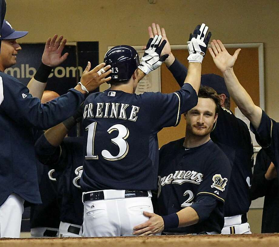 Milwaukee Brewers pitcher Zack Greinke (13)  receives congratulations in the dugout after hitting a home run against the Washington Nationals in the fifth inning of a baseball game, Wednesday, May 25, 2011, in Milwaukee. Photo: Jeffrey Phelps, AP