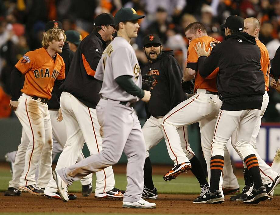 Giants players congradulate Aubrey Huff on his game winning hit in the bottom of the 10th inning as the San Francisco Giants play the Oakland  Athletics at AT&T Park in San Francisco Calif, on Friday, May 20, 2011. Photo: Alex Washburn, The Chronicle