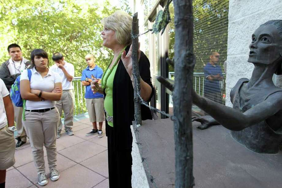 "Becky Ebner Hogg of San Antonio's Holocaust Memorial Museum uses a sculture, ""The Last Butterfly,"" to talk to students about bullying. Photo: Jennifer Whitney, Special To The Express-News / special to the Express-News"