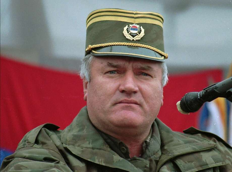 FILE - In this Dec. 2, 1995 photo, Bosnian Serb army commander Gen. Ratko Mladic addresses his troops in the eastern Bosnian town of Vlasenica.  Mladic, Europe's most wanted war crimes fugitive, has been arrested in Serbia, the country's president said Thursday, May 26, 2011. Mladic has been on the run since 1995 when he was indicted by the U.N. war crimes tribunal in The Hague, Netherlands, for genocide in the slaughter of some 8,000 Bosnian Muslims in Srebrenica and other crimes committed by his troopsduring Bosnia's 1992-95 war. Photo: Oleg St. Jepanovic, AP