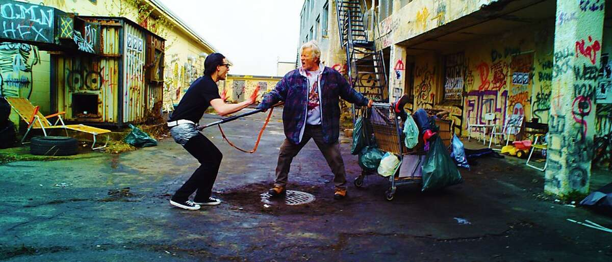 Gregory Smith and Rutger Hauer in HOBO WITH A SHOTGUN, a Magnet Release.
