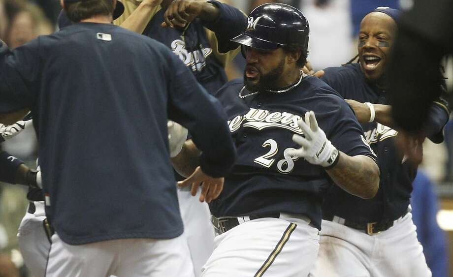 Milwaukee Brewers' Prince Fielder is mobbed by teammates after hitting a two-run walk off home run during the 14th inning of a baseball game against the Colorado Rockies Friday, May 20, 2011, in Milwaukee. Photo: Morry Gash, AP