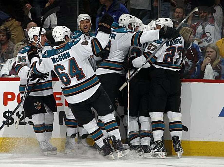 Members of the San Jose Sharks surround center Joe Pavelski after he scored the winning goal against the Colorado Avalanche in the Sharks' 2-1 overtime victory in Game 4 of the teams' NHL Western Conference first-round playoff series in Denver on Tuesday,April 20, 2010. Photo: David Zalubowski, AP