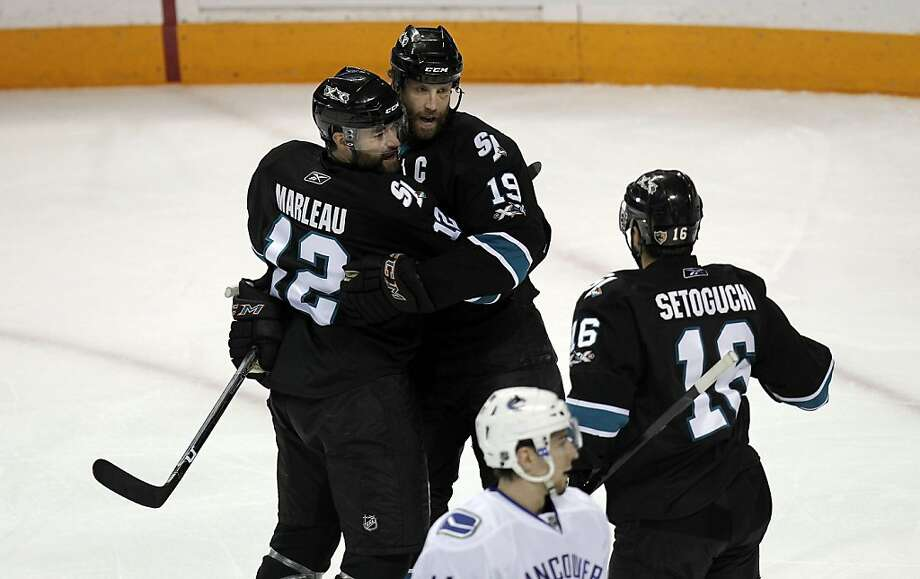 San Jose Sharks Patrick Marleau (12), Joe Thornton (19) and Devin Setoguchi (16) celebrate Marleau's first period goal against the Vancouver Canucks in Game 3 of the Western Conference finals at the HP Pavilion in San Jose on Friday. Photo: Michael Macor, The Chronicle