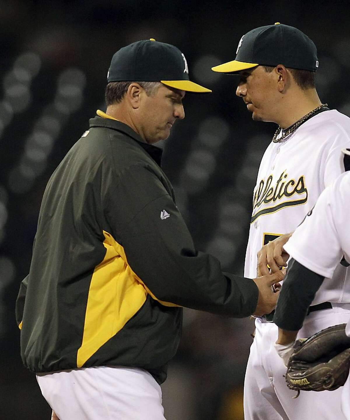 Oakland Athletics manager Bob Geren, left, takes the ball from pitcher Brian Fuentes during the ninth inning of a baseball game Tuesday, May 3, 2011, in Oakland, Calif.