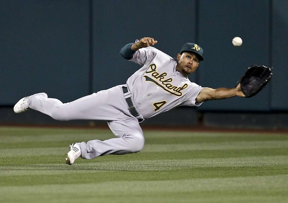 Oakland Athletics center fielder Coco Crisp catches a ball hit by Los Angeles Angels' Maicer Izturis during the fifth inning of a baseball game in Anaheim, Calif., Tuesday, May 24, 2011.