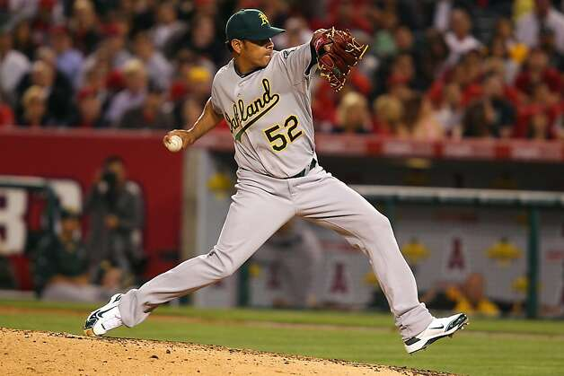 ANAHEIM, CA - MAY 24:  Guillermo Moscoso #52 of the Oakland Athletics pitches in the fifth inning against the Los Angeles Angels of Anaheim during the game at Angel Stadium on May 24, 2011 in Anaheim, California. Photo: Joe Scarnici, Getty Images