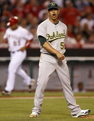 Oakland Athletics starting pitcher Guillermo Moscoso celebrates the last out against the Los Angeles Angels in the sixth inning of a baseball game in Anaheim, Calif., Tuesday, May 24, 2011. Photo: Chris Carlson, AP