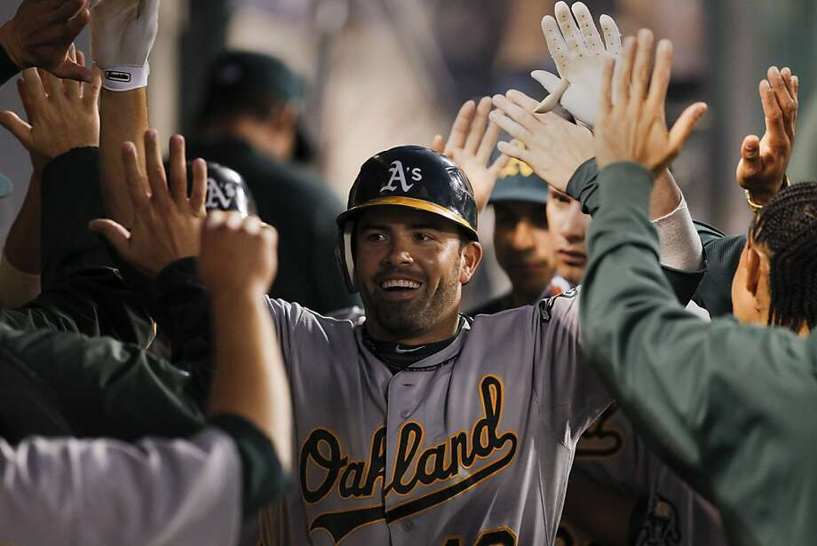 Oakland Athletics' David DeJesus celebrates his two run home run against the Los Angeles Angels during the fourth inning of a baseball game in Anaheim, Calif., Tuesday, May 24, 2011. Photo: Chris Carlson, AP