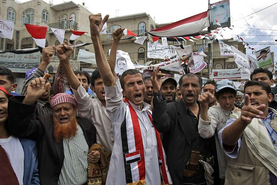 "Anti-government protestors, shout slogans during a demonstration demanding the resignation of Yemeni President Ali Abdullah Saleh, in Sanaa, Yemen, Wednesday, May 25, 2011. Yemen's embattled President Ali Abdullah Saleh issued messages of hard-line defiance Wednesday even as intense battles raged in the heart of the capital for a third day, saying he will not step down or allow the country to become a ""failed state.""  (AP Photo/Hani Mohammed) Photo: Hani Mohammed, AP"
