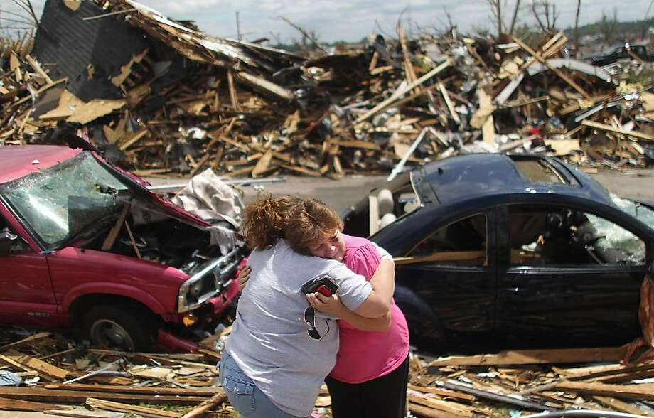 JOPLIN, MO - MAY 26:  Jackie McGuirk (R) hugs her best friend Dana Roller outside McGuirk's destroyed home after a massive tornado passed through the town killing at least 125 people on May 26, 2011 in Joplin, Missouri. The town continues the process of recovering from the storm which damaged or destroyed an estimated 8,000 structures.  (Photo by Mario Tama/Getty Images)  ***BESTPIX *** Photo: Mario Tama, Getty Images