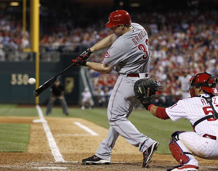 Cincinnati Reds' Jay Bruce hits a three-RBI double off Philadelphia Phillies relief pitcher Ryan Madson, not pictured,  in the ninth inning of a baseball game, Tuesday, May 24, 2011, in Philadelphia. Cincinnati won 6-3. At right is Carlos Ruiz. Photo: Matt Slocum, AP