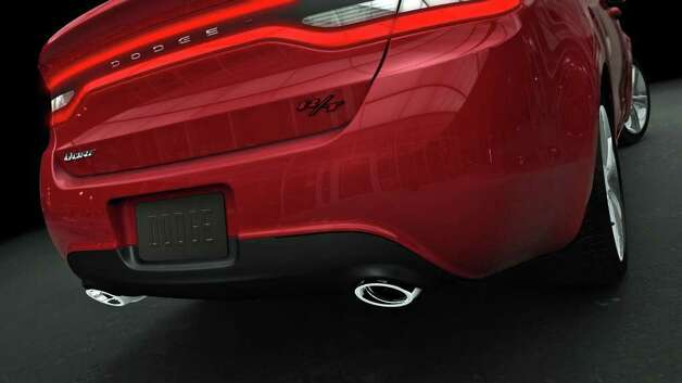 Although no full photos of the new 2013 Dodge Dart have been released yet, this partial rear view shows the sporty R/T model, which includes dual exhaust outlets and a rear-deck spoiler. COURTESY OF CHRYSLER GROUP LLC Photo: Chrysler Group LLC., COURTESY OF CHRYSLER GROUP LLC