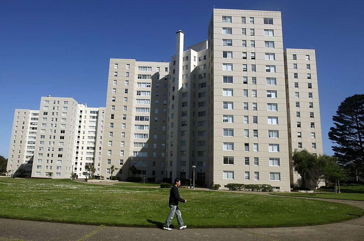 A resident walks through the grounds of the Park Merced neighborhood in San Francisco, Calif., on Thursday, June 10, 2010. Owners of the sprawling complex of houses and high-rise apartment buildings plan to proceed with a $1.2 billion renovation project despite defaulting on their mortgage.