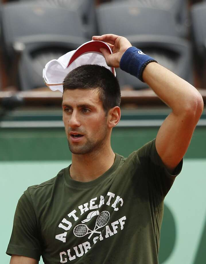 Serbia's Novak Djokovic reacts during a training session at Roland Garros stadium in Paris, Friday May, 20, 2011. Photo: Christophe Ena, AP