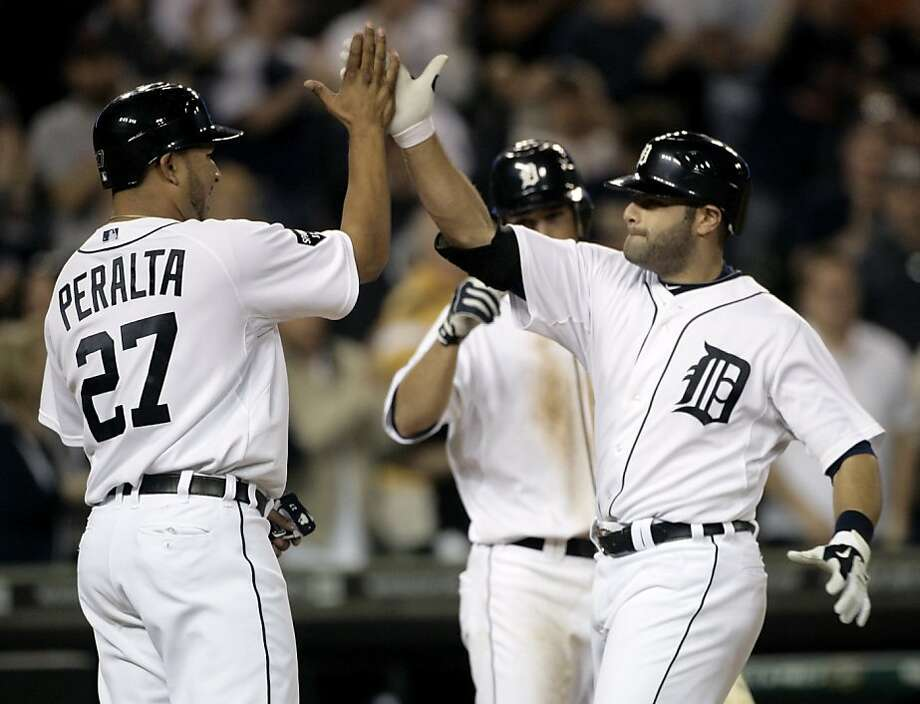 Detroit Tigers' Alex Avila, right, is congratulated by Jhonny Peralta after hitting a game winning two-run home run against the Tampa Bay Rays in the eighth inning of a baseball game Tuesday, May 24, 2011 in Detroit. The Tigers defeated the Rays 7-6. Photo: Duane Burleson, AP