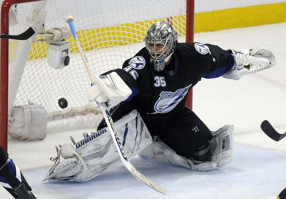 Tampa Bay Lightning goalie Dwayne Roloson is unable to stop the puck on a goal by Boston Bruins right wing Michael Ryder in the first period of Game 4 of the NHL hockey Stanley Cup playoffs Eastern Conference final, Saturday, May 21, 2011, in Tampa, Fla. Photo: Phelan M. Ebenhack, AP