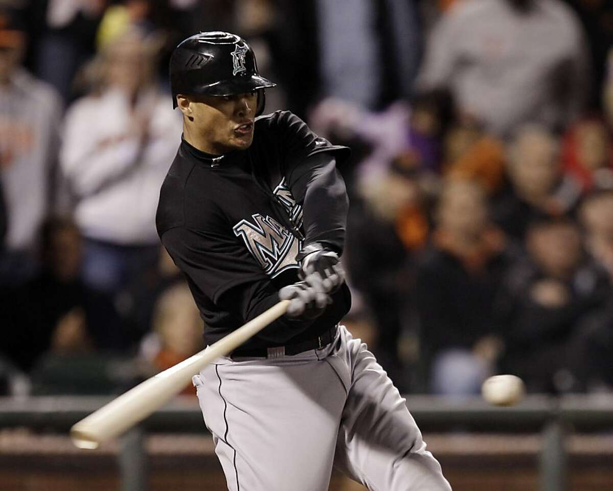 Florida Marlins' Mike Stanton drives in three runs with a bases loaded double against the San Francisco Giants during the ninth inning of a baseball game in San Francisco, Wednesday, May 25, 2011.