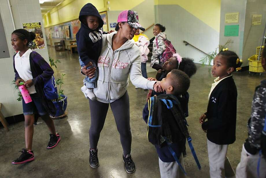 Erica Griffin, first grade parent and member of the School Site Council and member of the Mom's Club, greets children on the way to class as part of the welcoming committee at Sankofa Academy in Oakland, Calif., Wednesday, May 18, 2011. Photo: Lea Suzuki