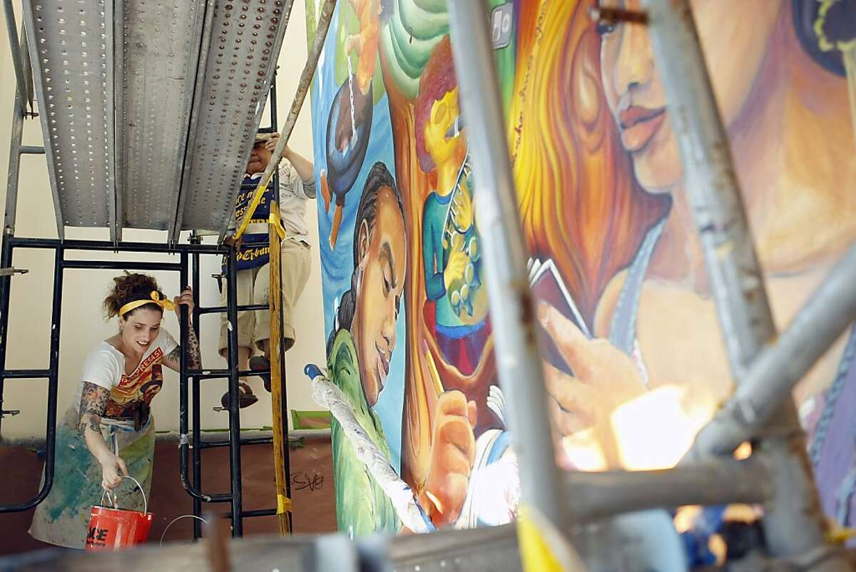 Michelle Munyer works on a mural at the YMCA Teen Center for credits at Berkeley City College in Berkeley Calif, on Thursday, May 19, 2011.