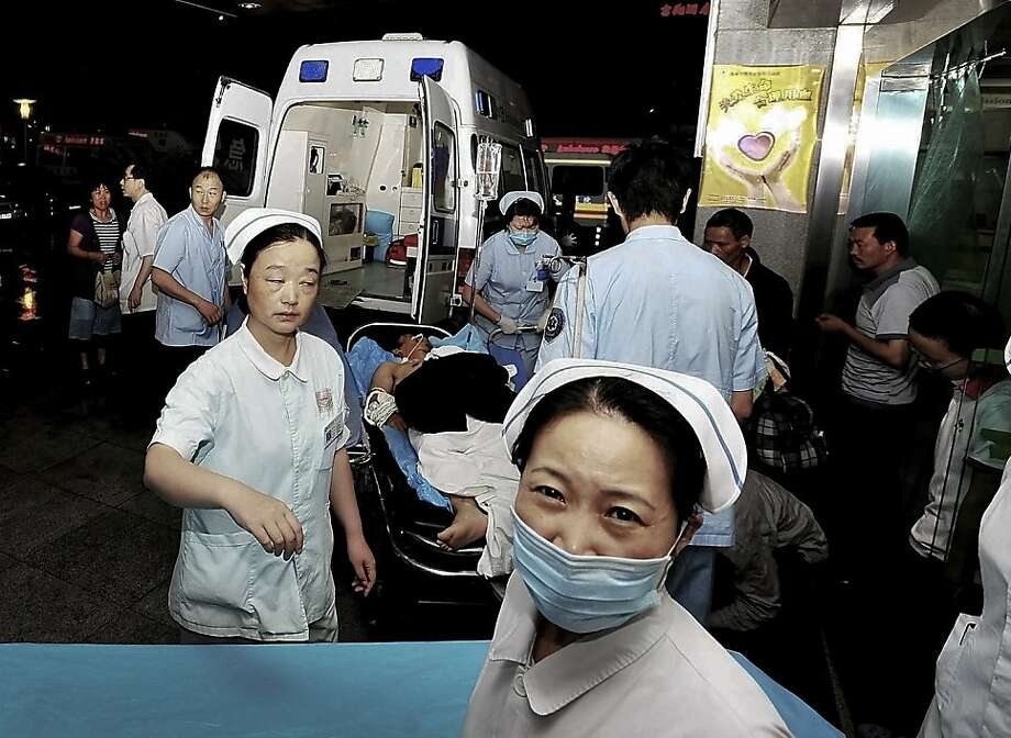 An injured man from a Foxconn factory, on a stretcher, arrives at a hospital in Chengdu in China's Sichuan province on Friday, May 20, 2011. Chinese media reports say two people have died following an explosion at the factory in southwestern China belonging to electronics maker Foxconn Technology Group, the world's biggest contract electronics manufacturer. Photo: AP