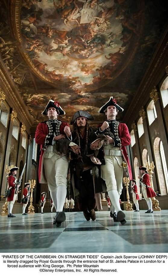 """PIRATES OF THE CARIBBEAN: ON STRANGER TIDES""  Captain Jack Sparrow (JOHNNY DEPP) is literally dragged by Royal Guards through the entrance hall of St. James Palace in London for a forced audience with King George. Photo: Peter Mountain, Disney Enterprises"