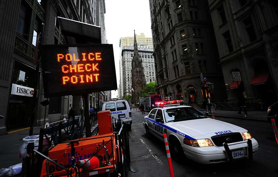 """A police check point is set at the entrance of the """"Ring of Steel"""" around Ground Zero in front of the building (back white behind church) where former IMF head Dominique Strauss-Khan is held under house arrest after posting bail, in New York, May 23, 2011.  Former IMF chief Dominique Strauss-Kahn raced against time Monday to find a new home in a city that does not want him after sex crime charges which he called a """"personal nightmare"""". Rejected by one luxury residence because of his new notoriety, the French politician, who is under house arrest pending trial, must soon leave his temporary abode and is battling to find somewhere that will have him. Photo: Emmanuel Dunand, AFP/Getty Images"""