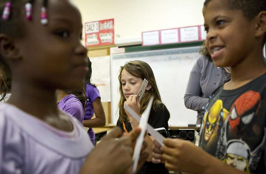 Loren Howard, Neely Odom and Joseph DuBose (left to right) participate in a lesson on gender diversity at Redwood Heights Elementary School in Oakland, Calif. on Monday, May 23, 2011.  The students were given cards describing gender differences in nature and then asked to read the cards aloud for the class. Photo: Laura Morton, Special To The Chronicle