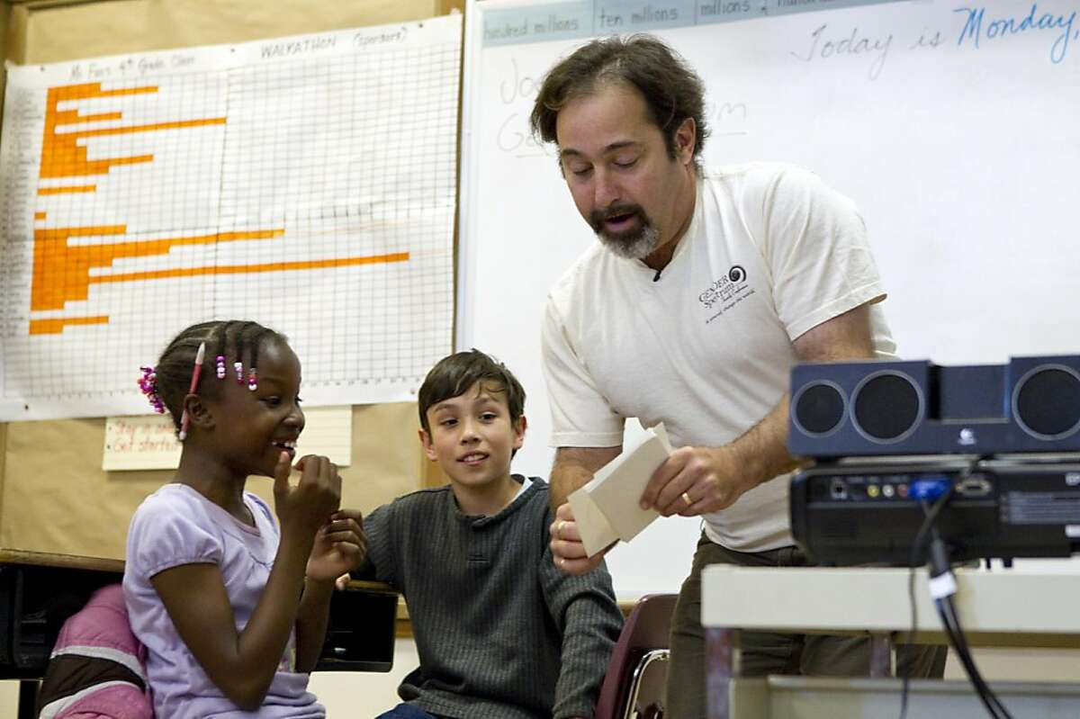 Joel Baum, the director of education and training for the organization Gender Spectrum, teaches a lesson on gender diversity to students including 9-year-old Loren Howard (left) and 10-year-old Clemente Ferrer at Redwood Heights Elementary School in Oakland, Calif. on Monday, May 23, 2011.
