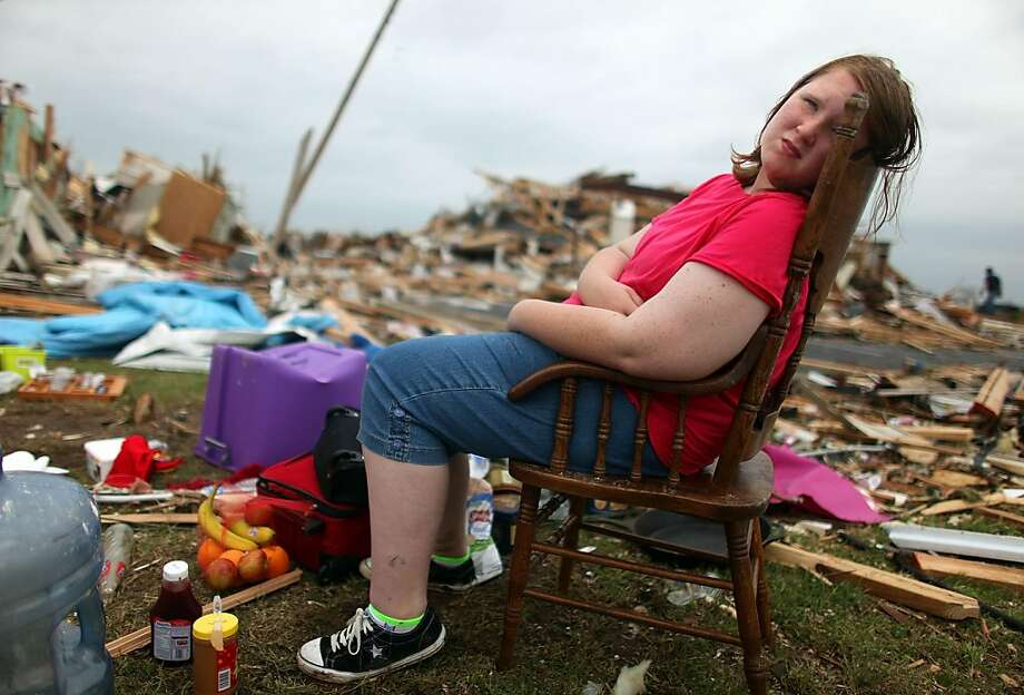 JOPLIN, MO - MAY 24:  Christal Comstock sits outside her family home which was destroyed when a massive tornado passed through the town killing at least 116 people May 24, 2011 in Joplin, Missouri. The tornado that ripped through the town of about 50,000people May 22, is being called the deadliest single tornado in the U.S. in 60 years. Photo: Mario Tama, Getty Images
