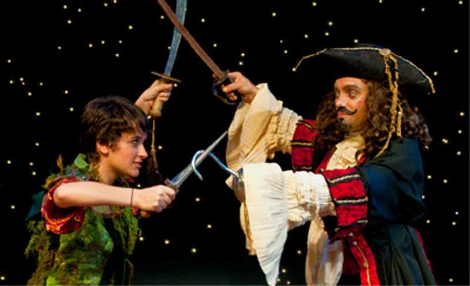 Peter Pan, left, played by Sara Curtis, crosses swords with Captain Hook, played by David Girard, in a scene from ??Peter Pan,?? which will be performed this weekend at Russell Sage College. (Rebekah Barton photo)