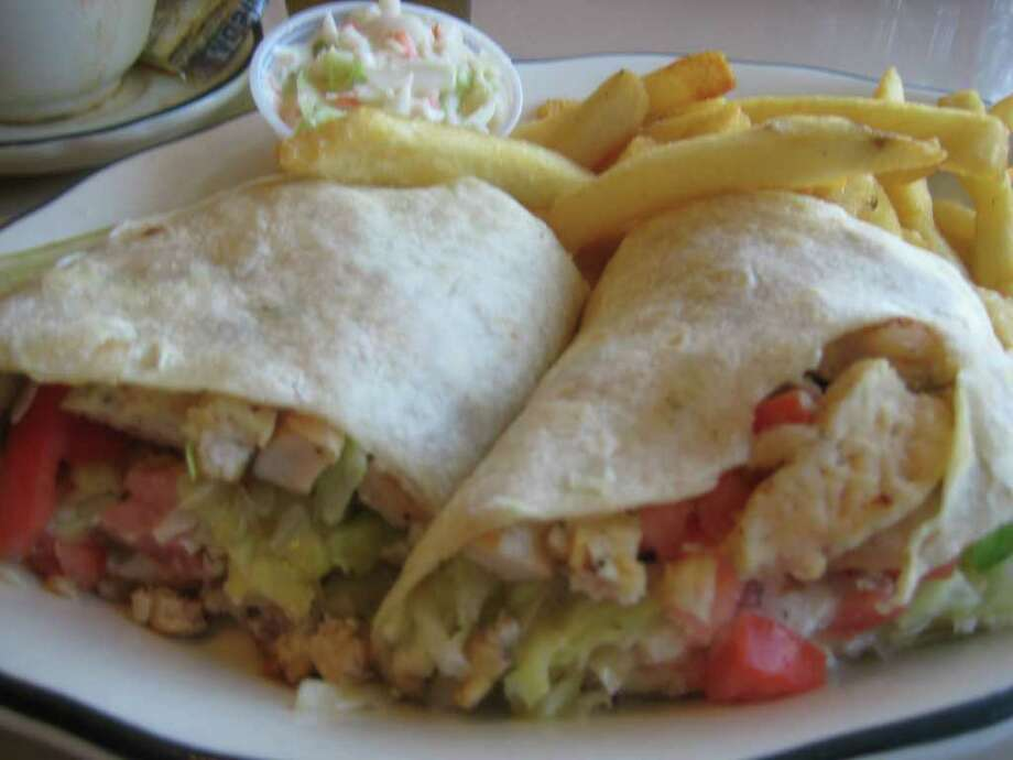 The Greek chicken wrap at the Wolf Road Diner is served with cole slaw and fries. (Pete Iorizzo / Times Union)