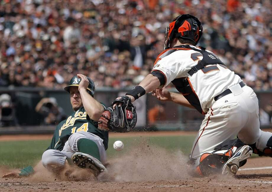 Oakland Athletics' Mark Ellis slides safely pass San Francisco Giants' Buster Posey during the 8th inning. As the San Francisco Giants take on the Oakland Athletics at AT&T Park in San Francisco, Calif., on Sunday, May 22, 2011. Photo: Thomas Levinson, The Chronicle