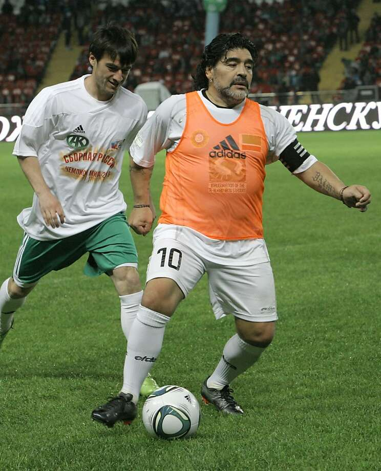 Diego Maradona, right, vies for a ball during a match between team of stars against local team in Grozny, Chechnya, Russia, early Thursday, May 12, 2011. The match has been arranged to mark the opening a new stadium in Grozny. Photo: Musa Sadulayev, AP