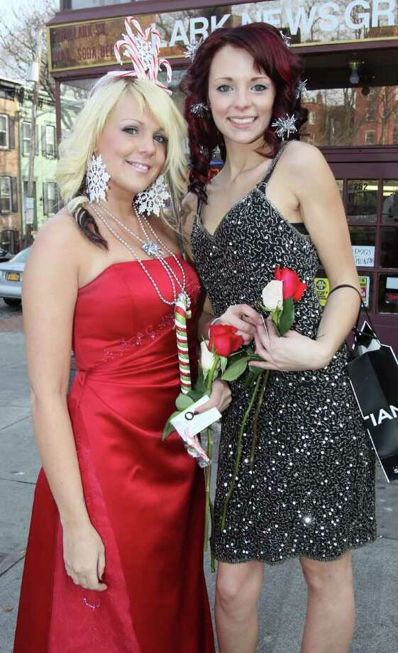Albany, NY - December 11, 2010 - (Photo by Joe Putrock/Special to the Times Union) - Ashley Ready(left) and Christine Harney(right) representing The Orlo School of Hair Design and Cosmetology handed out candy canes during Winter WonderLARK to benefit the Lark Street Business Improvement District. Photo: Joe Putrock / Joe Putrock