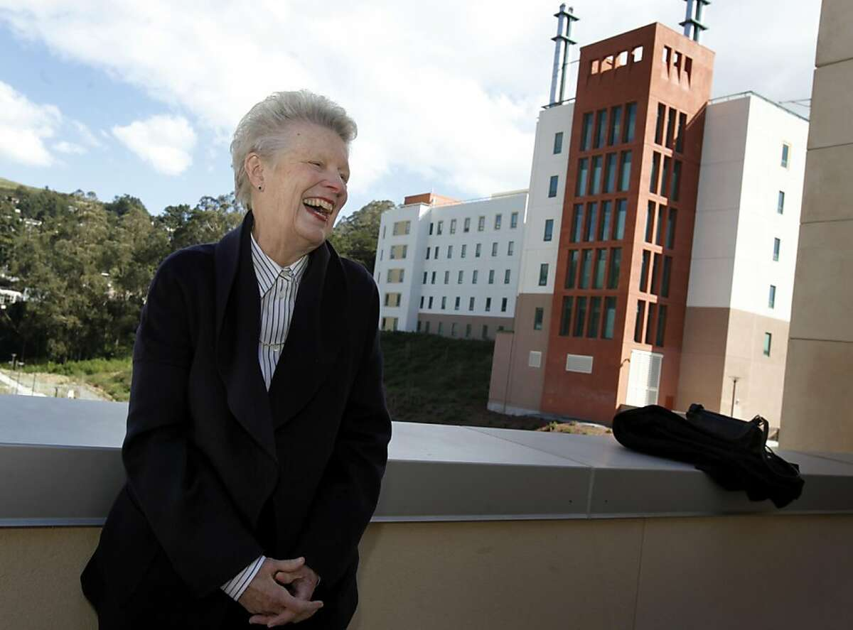 Louise Renne stood on one of the upper floors of the new hospital, some of which can be seen in the background. Louise Renne, former San Francisco supervisor and city attorney, has been instrumental in the rebuilding of Laguna Honda Hospital.