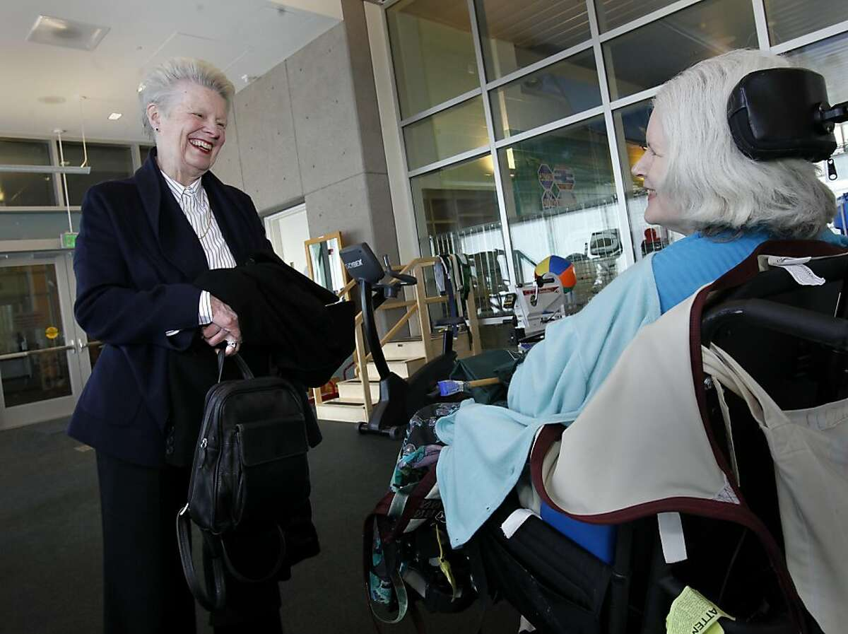 Louise Renne (left) stopped to talk with Elizabeth Cutler in the Wellness Center at the hospital. Louise Renne, former San Francisco supervisor and city attorney, has been instrumental in the rebuilding of Laguna Honda Hospital.
