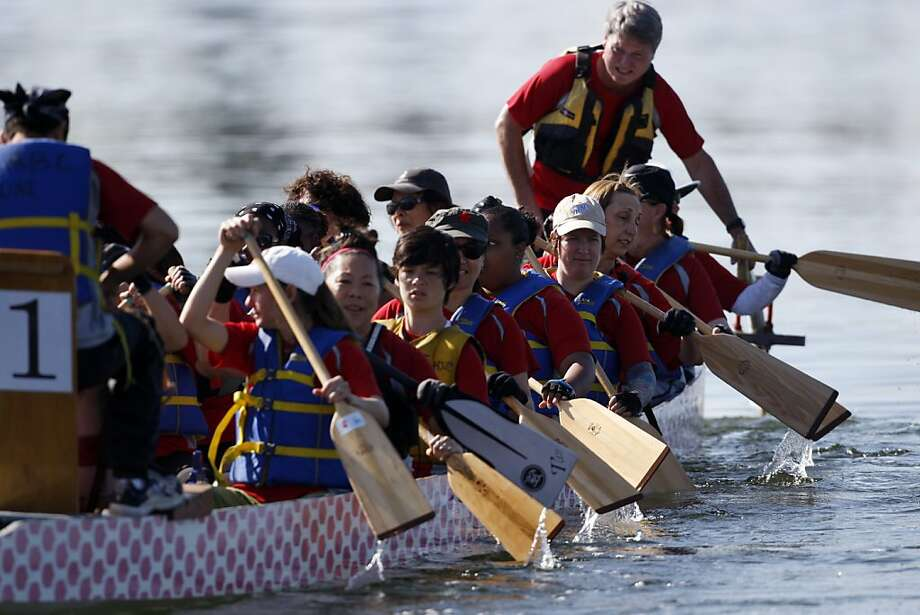 The Oakland Renegades row their boat in after a race during dragon boat racing at Lake Merrit in Oakland, Calif., on Sunday, May 1, 2011. Photo: Thomas Levinson, The Chronicle