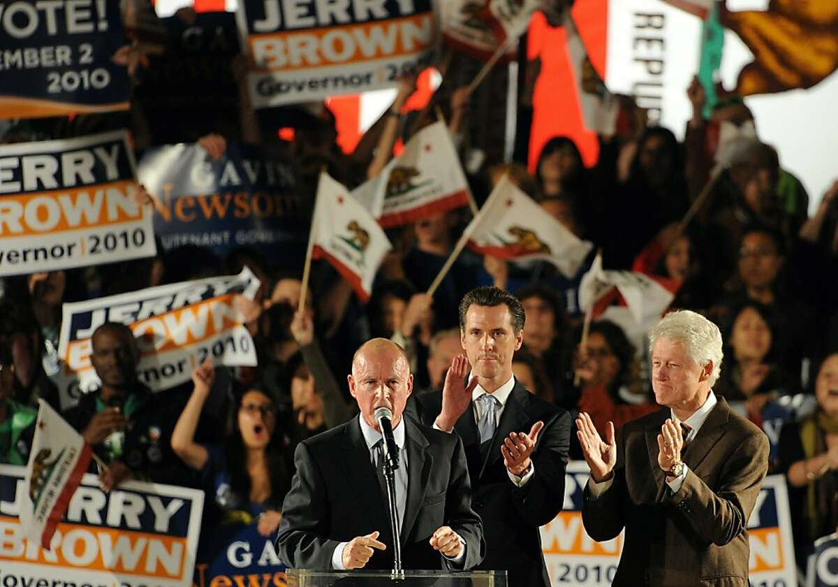 Former U.S. President Bill Clinton (C), Democratic gubernatorial candidate and California State Attorney General Jerry Brown (R) and San Francisco Mayor Gavin Newsom attend a Democratic National Committee rally on the campus of UCLA on October 15, 2010 inLos Angeles, California. Newsom is running for lieutenant governor against Republican incumbent Abel Maldonado.