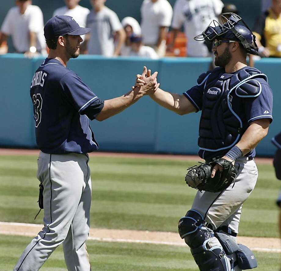 Tampa Bay Rays' pitcher James Shields, left, is greeted by catcher Kelly Shoppach after pitching a 4-0 shutout against the Florida Marlins during the ninth inning of an interleague baseball game at Sun Life Stadium in Miami, Sunday, May 22, 2011. Photo: Jeffrey Boan, AP