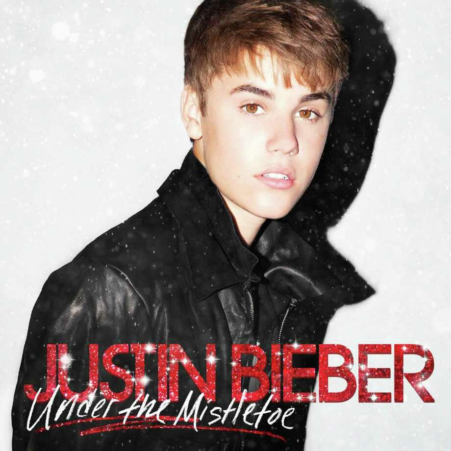 """In this CD cover image released by Island, the latest holiday album by Justin Bieber, """"Under the Mistletoe,"""" is shown. (AP Photo/Island)"""
