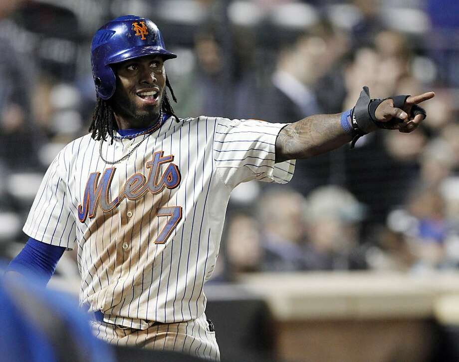 New York Mets' Jose Reyes (7) gestures to teammate Jason Bay after scoring on an RBI single by Bay during the seventh inning of a baseball game against the Los Angeles Dodgers, Friday, May 6, 2011, at Citi Field in New York. The Mets won 6-3. Photo: Frank Franklin II, AP