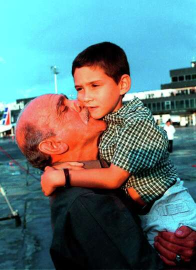 Elian Gonzalez is welcomed by his grandfather Rolando Betancourt Wednesday June 28, 2000 upon his ar