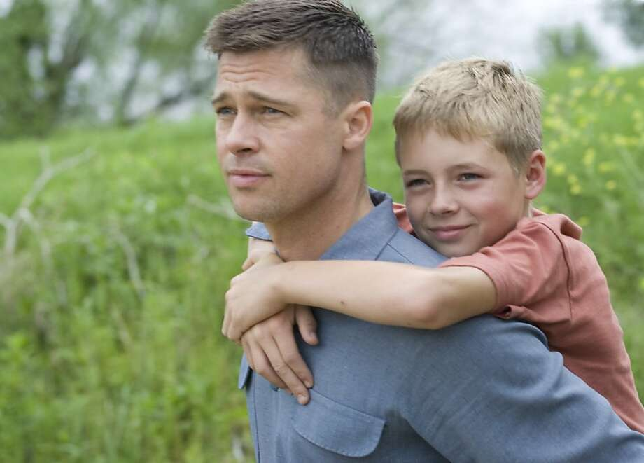 """In this publicity image released by Fox Searchlight films, Brad Pitt, left, and Laramie Eppler are shown in a scene from """"The Tree of Life."""" Photo: Merie Wallace, AP"""